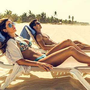 Couple lounging on beach